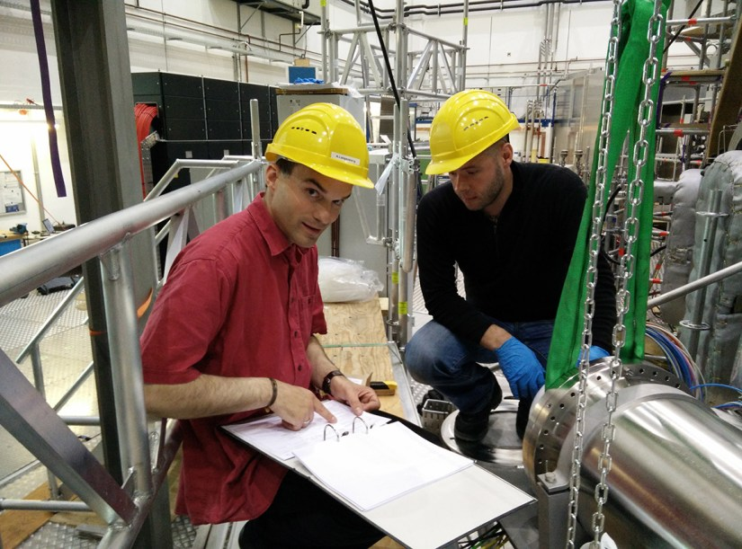PPPL physicist Novimir Pablant and Andreas Langenberg, of the Max Planck Institute, work in front of the housing for components of the X-Ray crystal spectrometer built by Pablant and PPPL engineer Michael Mardenfeld. (Photo by Scott Massidda)