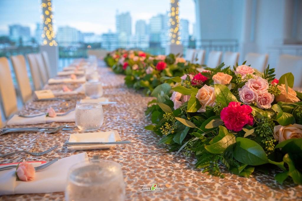 long low table centperiece w/fuschia & pastel blooms