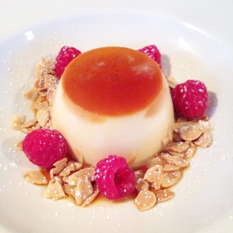 Caramel Pannacotta with raspberries and toasted almonds
