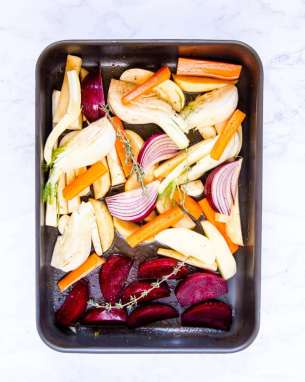 Hearty, earthy vegetables with a honey and sherry glaze, ready for baking.