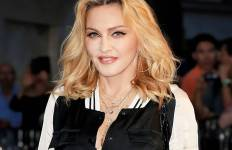 Madonna, singer-songwriter, actress, businesswoman and a uniquely controversial and controversially inspirational feminist as if these words were not associated enough even at the beginning of the 21st century