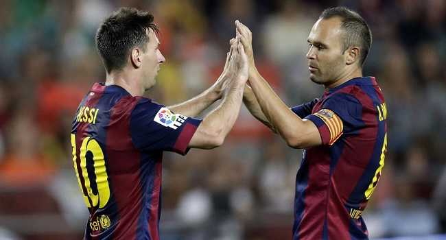 123114-SOCCER-Lionel-Messi-and-Andres-Iniesta-of-FC-Barcelona-PI.vresize.1200.675.high.20