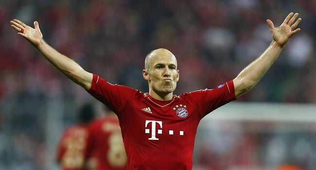 Bayern Munich's Arjen Robben celebrates after scoring a goal against Barcelona during their Champions League semi-final first leg soccer match in Munich