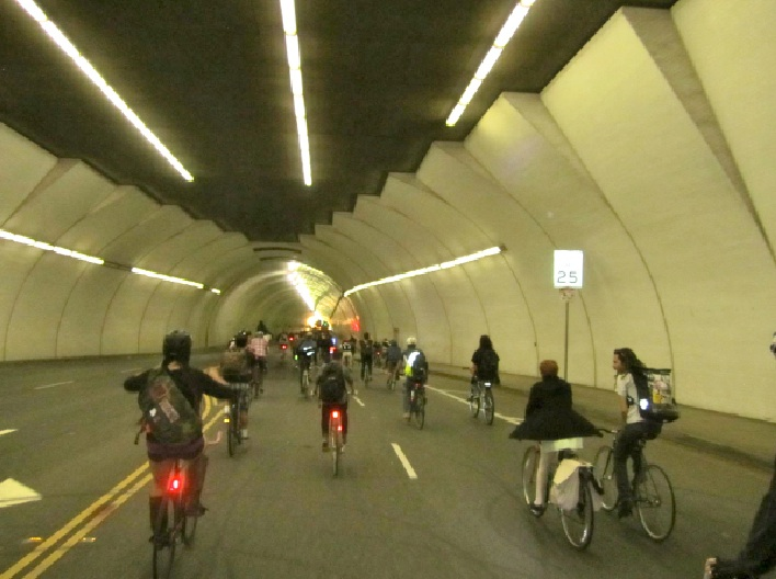 Riders making noise in the Second Street Tunnel during the Eddieboy Memorial Ride on August 16, 2013