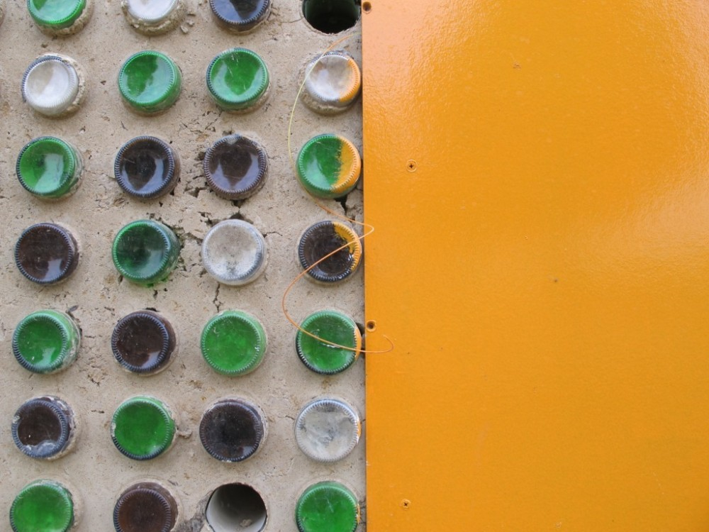 Bottle bricks were manufactured by the community to construct some of the walls of the solar-powered bakery. Image Courtesy of Architecture for a Change