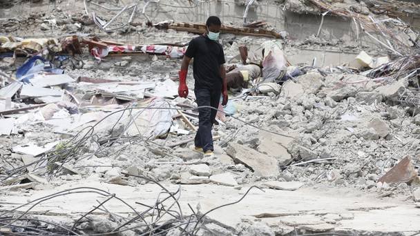 Rescue workers search for survivors in the rubble of a collapsed building in Lagos, Nigeria (AP) Source: Belfast Telegraph
