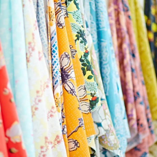 Brightly coloured fabric on racks