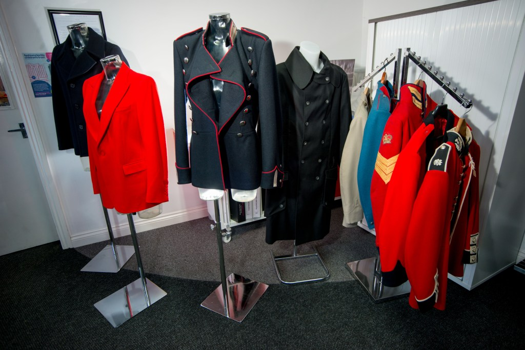 Four mannequins and a display rail showing a variety of jackets in different colours and cuts