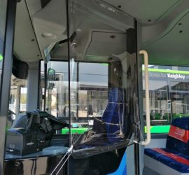 Protective screen fitted to the drivers' cabin on a bus by Canvasman Ltd