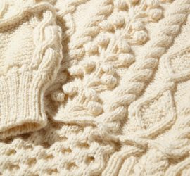 Detail of cream cable-knit jumper