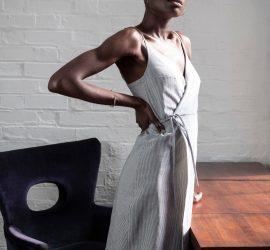 Model wears long grey wrap dress