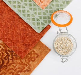 Brown, terracotta and pale green samples of flax leather, featuring Celtic design motifs