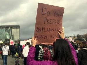 Protest sign at Oakland Women's March: Do you prefer UN-planned parenthood?