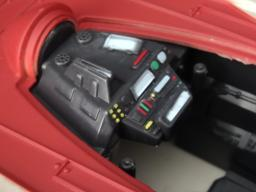 The multi-color painted cockpit sports two joysticks (non-moving)
