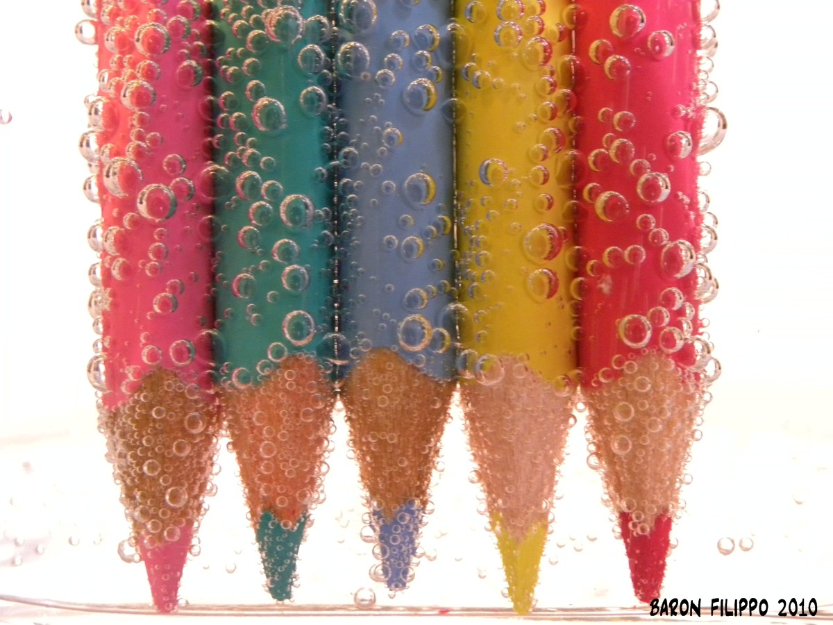 Photo of colored pencils in sparkling water