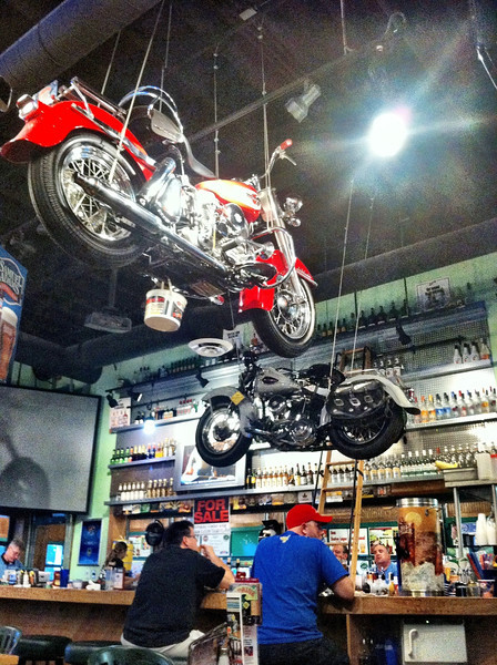 Bucket under suspended motorcycle