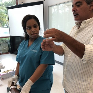 Instructor shows tube to student