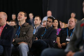 Audience listening to a talk on the main stage