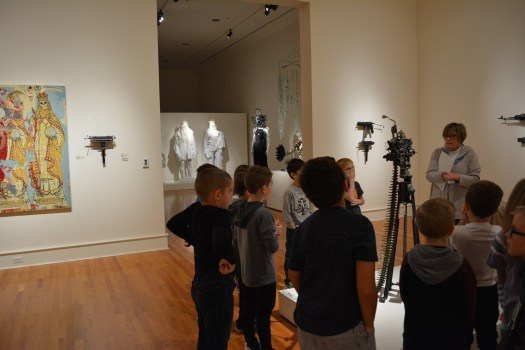FWMoA Docent Jennifer leads students in a discussion of Ravi Zupa's gun sculptures made out of typewriters.