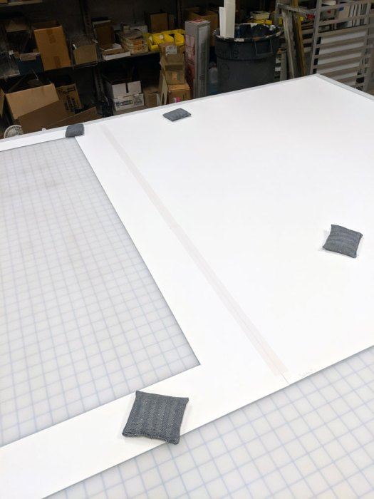 An example of a hinged matboard. If you look closely, you can see the piece of linen tape running down the middle, forming the hinge between the back mat and the window.