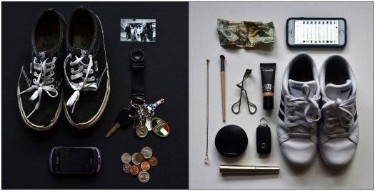 A photograph of dual possessions: on the left, Vans sneakers, a watch, keys, pocket change, and a cheap phone; on the right, Adidas sneakers, an iPhone, a crumpled 20, a key fob carkey, and expensive make-up products.