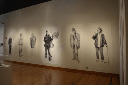 An installation shot of Phillips' life-size drawings of his homeless neighbors in San Francisco.