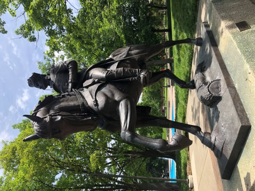 The sculpture of Major General Anthony Wayne in Freimann Square shows the General seated on his horse.