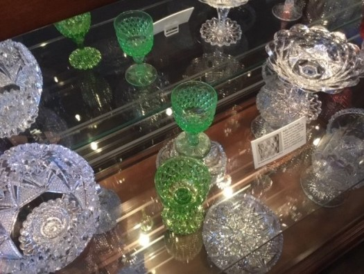 Pieces of the Brilliant Cut Glass, including glasses and serving dishes.