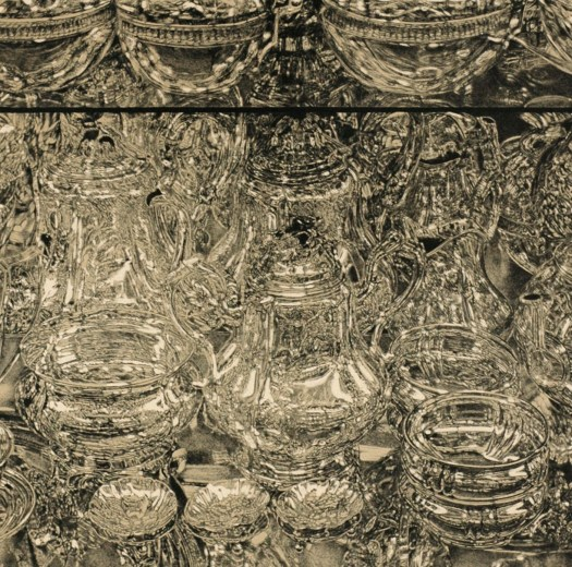 Don Eddy's lithograph is a still life of glasses and the reflections of glasses, making it appear as if the work goes on forever/is mirrored.