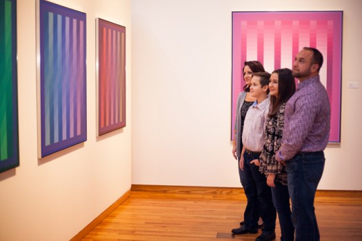 A family looks at a grouping of Stanczak paintings at a previous exhibition on display at the museum.
