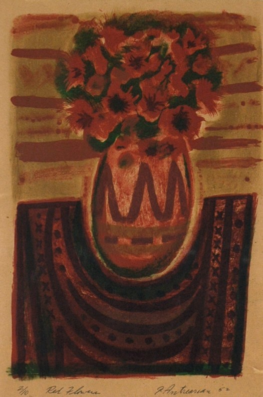 This lithograph shows a vase of red flowers on a table. The background is a murky mix of browns and reds, while a textured cloth rests on the table underneath the vase.  The artist's signature is in the bottom right-corner, while the edition and title are in the bottom-left.