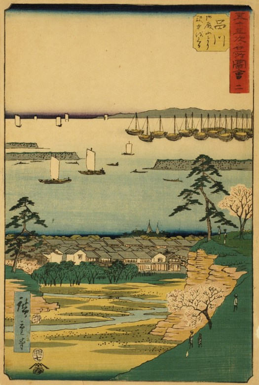 This woodcut shows a Japanese landscape. In the foreground, a green hill, dotted with trees, overlooks a village with houses. In front of the village, a meandering rivers runs off the composition. In the background the village recedes into an ocean view, with boats out in the winter. In the very back, a mountain range stands tall against a gloomy, cloudless sky.