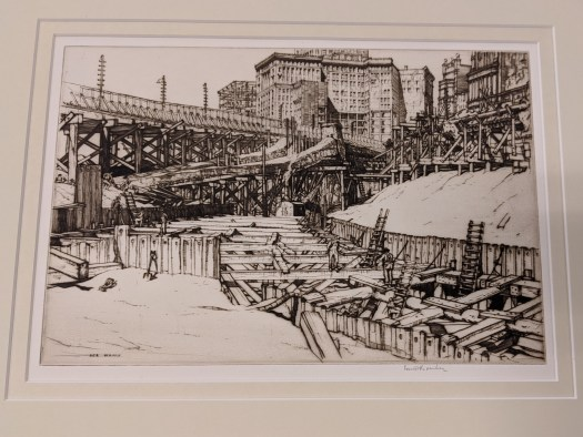 An etching of the track grading for the train on Ontario Street. In black and gray, the background shows the buildings of downtown Cleveland while the foreground illustrates the workers standing on and placing the grading for the track.