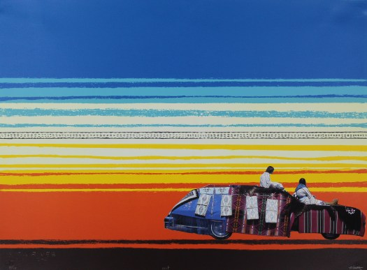Two women sit atop a car covered in blankets looking away from the viewer toward the sunset of yellow and orange bands below the blue bands of the sky.