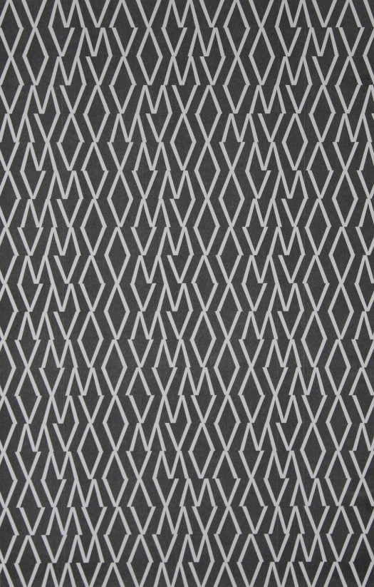 This print has an entirely black background, with a repeated pattern of a V and M in white, alternating through the whole page.