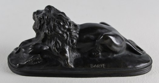 The back of the lion, we can see his powerful haunches and the front of the antelope's head as his mane streams down the side of the lion's neck. Below the lion's haunch is the artists name: BARYE.