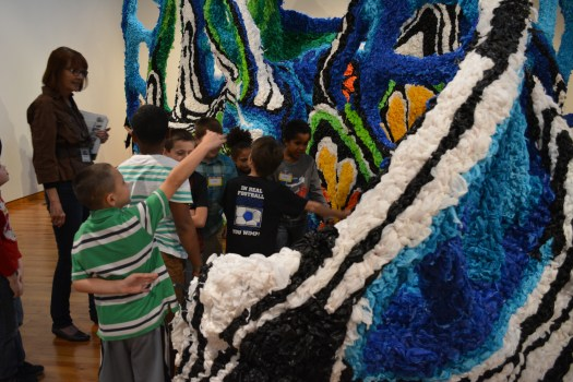 School children are enthralled by Crystal Wagner's installation piece, which encouraged visitors to walk around, and, even through it!