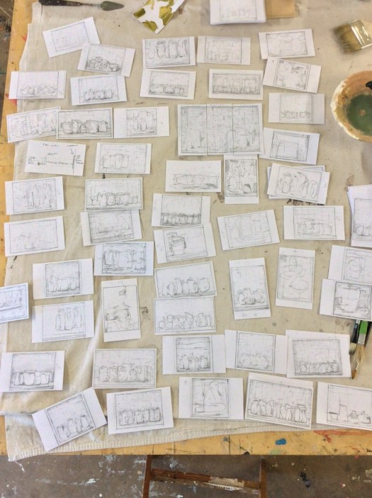 An assortment of sketches that the artist reviews to find inspiration for his finished, painted work.