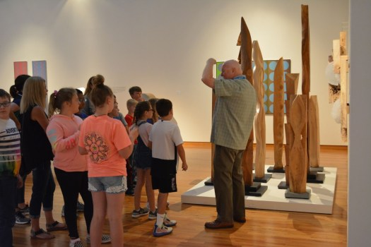 Docent Michael Greene leads elementary students on a tour of the museum.