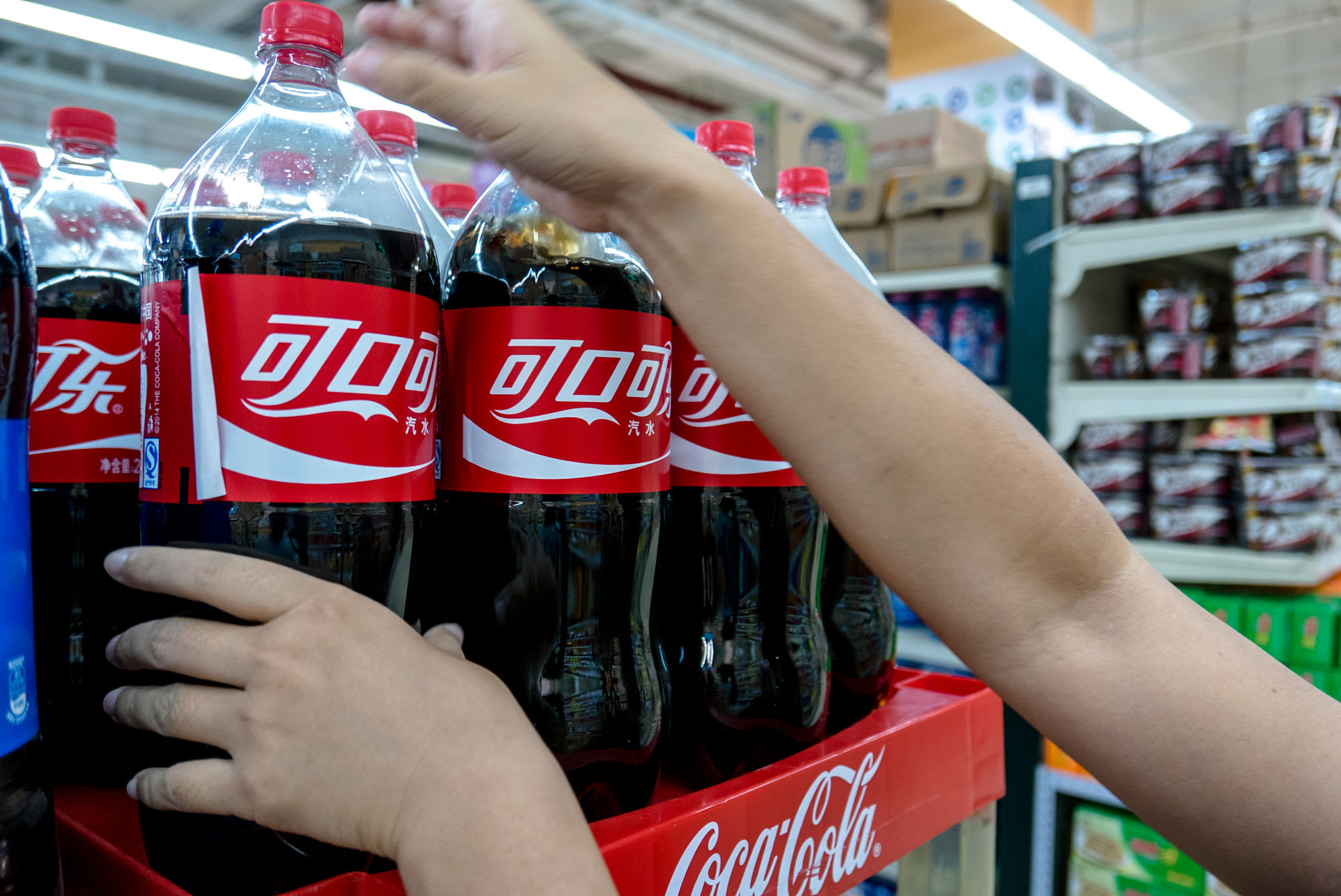 Coca-Cola takes an earnings hit, Iran confirms extra circumstances