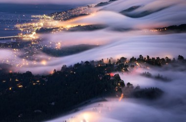 Fog flows over the hills of Marin county.