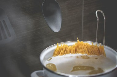 Spaghetti in a pot of boiling water.