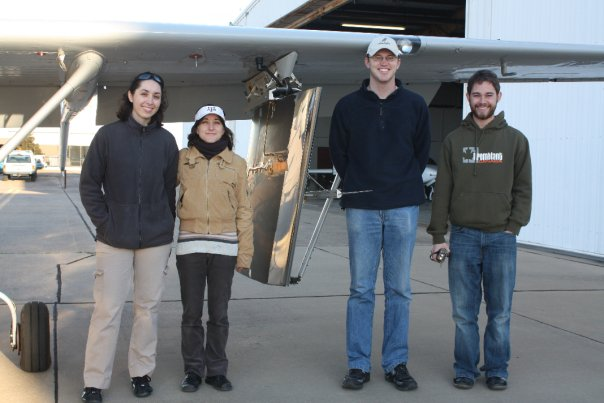 A model wing suspended on Texas A&M's Cessna O-2 flight research aircraft. Plus the Flight #500 crew.