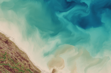 Sediments swirl along the coast of the Hudson Bay.