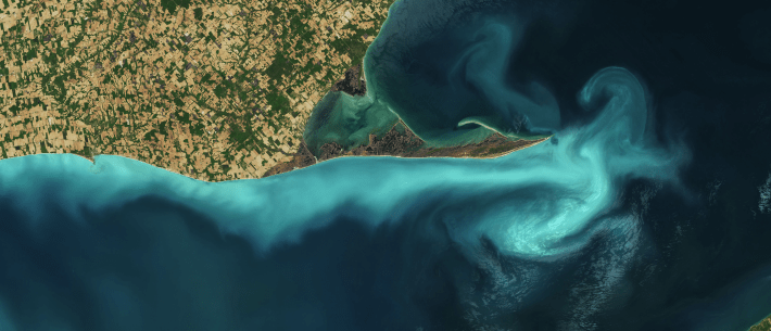 Light-colored limestone sediments are suspended in Lake Erie in this natural-color image.