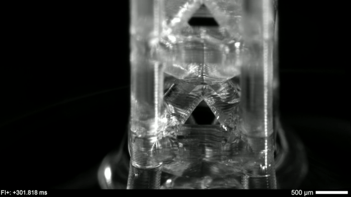 Close-up view of a single, 3D-printed unit cell as capillary action fills it.