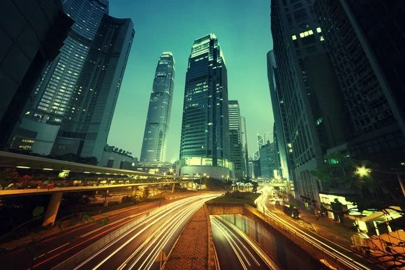 A slow-shutter picture of nighttime traffic in Hong Kong.