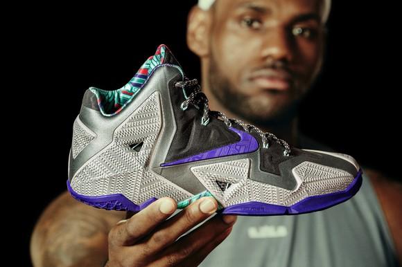 LeBron James holding his latest shoe design.