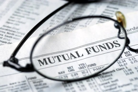 Mutual fund newspaper with glasses.