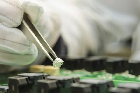 A microchip being installed.